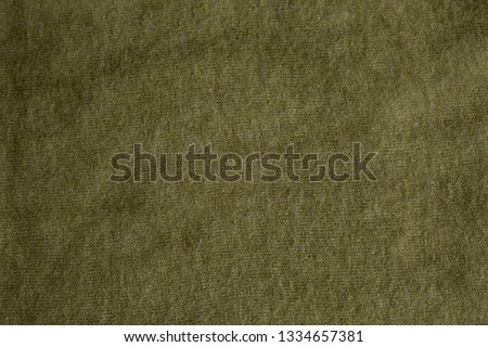background texture fabric Angora. the fabric is knit. fabric Angora. the fabric is dark green color #1334657381