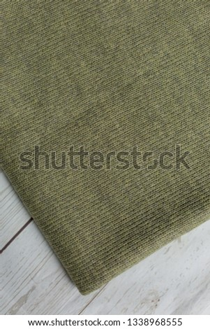 background texture fabric Angora. the fabric is knit. fabric Angora. the fabric is dark green color #1338968555