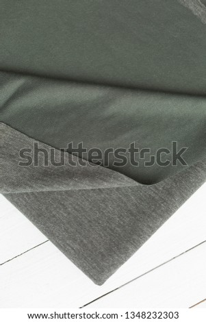 background texture fabric Angora. the fabric is knit. fabric Angora. the fabric is dark green color