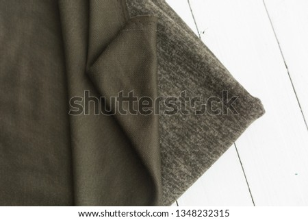 background texture fabric Angora. the fabric is knit. fabric Angora. the fabric is dark green color #1348232315