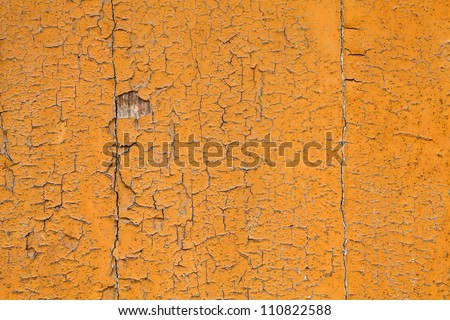 background texture from wooden surface with cracked paint