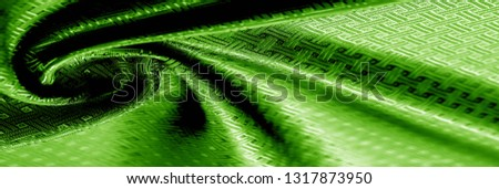 Background texture green silk fabric with a small checkered pattern. When you take home this green orchid brocade. Adding a 3D view to brocade. Thin and light, its flexible drape falls on some volume