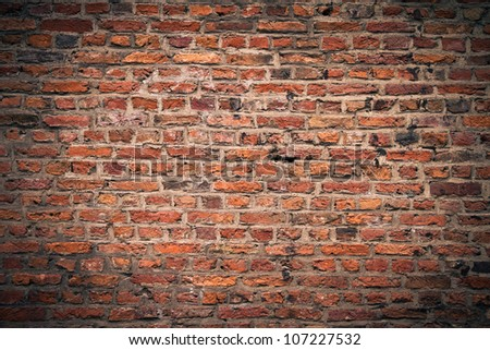 background texture of a brick wall with darker vignette