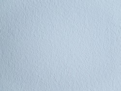 Background texture of a plain white, textured ingrain wallpaper
