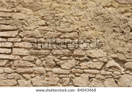 background texture of a yellow brick wall