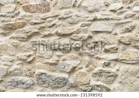 background texture of an old granite wall restored