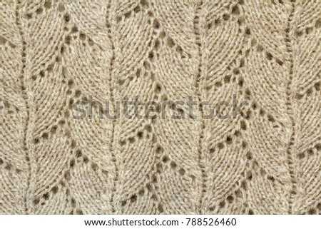 a3a935c33239 Background texture of beige pattern knitted fabric made of cotton or wool  closeup