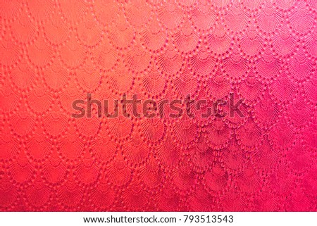 Background - texture of corrugated glass of crimson color.