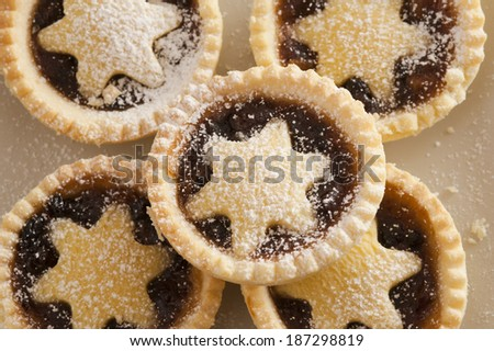 Background texture of decorative Christmas mince pies with crisp golden crusts and pastry stars for a traditional seasonal treat