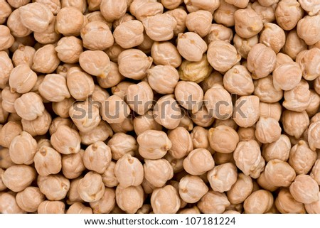 Background texture of dried white chickpeas, or garbanzo beans.