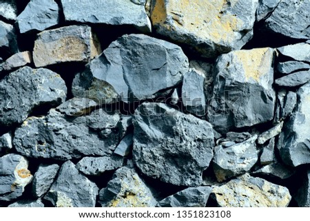 Background texture of natural gray stone of different sizes. Cropped shot, horizontal, close-up, nobody, top view. Concept of construction and nature. #1351823108