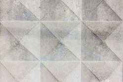Background texture of old gray concrete fence with square pattern. Geometric pattern