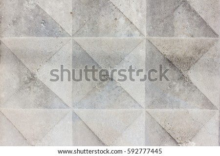 Background texture of old gray concrete fence with square pattern. Geometric pattern #592777445