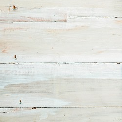 Background texture of painted or whitewashed white wooden boards with a mottled brushstroke pattern in square format with copyspace for your text