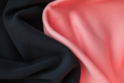 Background texture of pink and black fleece, soft napped insulating fabric made of polyester, vertical photo