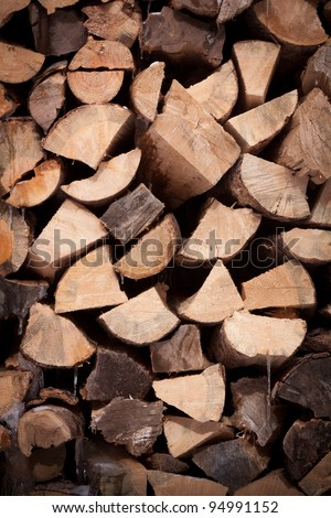Background Texture of Split Ends of Firewood Stack