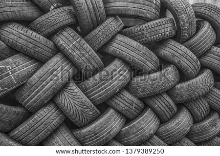 Background, texture of the wall of tires laid at an angle. Black tire rubber, vehicle part, spare part. #1379389250