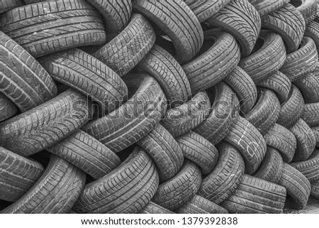 Background, texture of the wall of tires laid at an angle. Black tire rubber, vehicle part, spare part. #1379392838