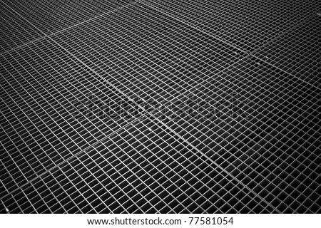 Background texture of tiled metal ground grid - stock photo