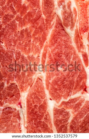 Background texture of uncooked fatty meat for use as a cooking ingredient
