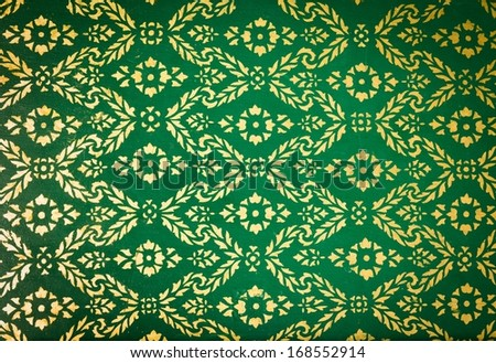 background texture of vintage pattern in traditional Thai style art painting on temple wall