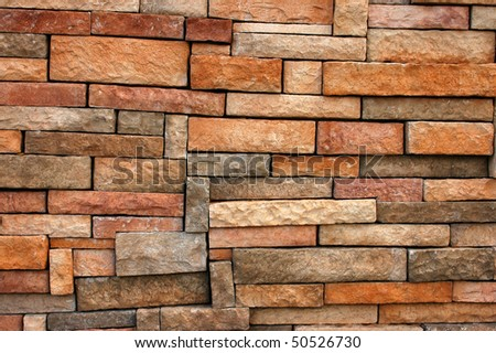 Background texture of wall with uneven sized bricks