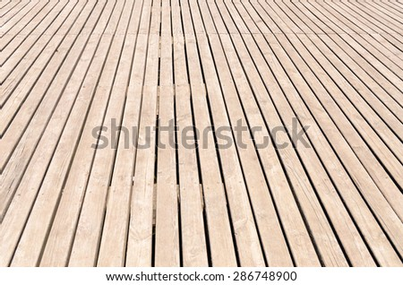 Background texture of wooden decking with parallel planks with gaps ...