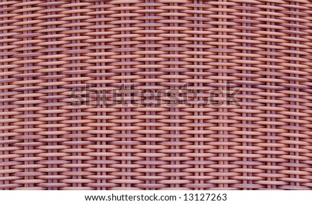 Background texture or pattern from a basket, woven with natural tan cane