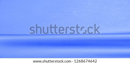 background texture, pattern. blue silk fabric. This lightweight fabric has a brilliant shine that perfectly reflects the light and crumpled texture that adds interest and depth to any fabric design. #1268674642