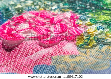 background texture; pattern. Cloth with glued lace stripes. Multicolored lace with sparkles; cording and metallic embroidery. Beautiful traditional lace for design #1155417103