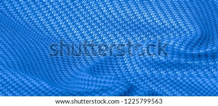 Background texture, pattern Fabric warm wool with stitched blue thread. Introducing our blue Wool Knitting this fabric will keep you in the cozy environment of your design a fantastic choice! #1225799563