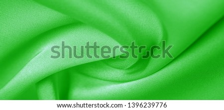 background texture, pattern. Green emerald silk fabric. This will add complexity to your design style. Its structural style characteristics are great for some of your decisions, wallpapers, posters. #1396239776