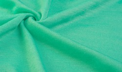 Background, texture, pattern, green wool fabric, thin soft curly or wavy hair forming the hair of a sheep, goat or similar animal, especially when they are used in the manufacture of fabric or yarn
