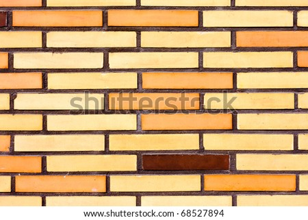 Background texture pattern of exterior wall with colorful fake brick siding.