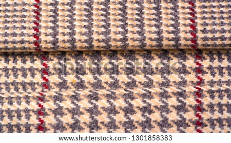 Background texture, pattern. The fabric is thick, warm in a cage, beige. This is 100% wool terry dressing. Sinil has a soft pile and is very versatile. It fits your design. #1301858383