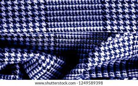 Background texture, pattern. The fabric is thick, warm with a checkered pattern, blue. Stop. You made the right choice by purchasing this photo, your design will be great with this image. #1249589398