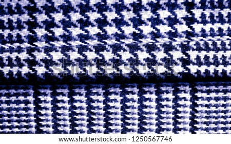 Background texture, pattern. The fabric is thick, warm with a checkered pattern, blue. Stop. You made the right choice by purchasing this photo, your design will be great with this image. #1250567746