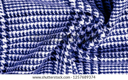 Background texture, pattern. The fabric is thick, warm with a checkered pattern, blue. Stop. You made the right choice by purchasing this photo, your design will be great with this image. #1257689374