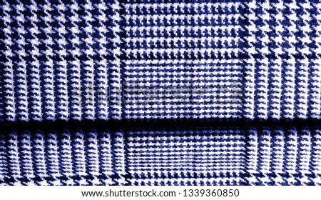Background texture, pattern. The fabric is thick, warm with a checkered pattern, blue. Stop. You made the right choice by purchasing this photo, your design will be great with this image. #1339360850