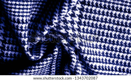 Background texture, pattern. The fabric is thick, warm with a checkered pattern, blue. Stop. You made the right choice by purchasing this photo, your design will be great with this image. #1343702087