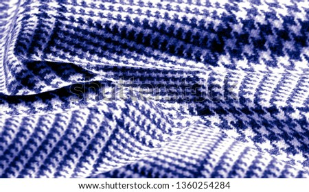 Background texture, pattern. The fabric is thick, warm with a checkered pattern, blue. Stop. You made the right choice by purchasing this photo, your design will be great with this image. #1360254284