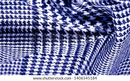 Background texture, pattern. The fabric is thick, warm with a checkered pattern, blue. Stop. You made the right choice by purchasing this photo, your design will be great with this image. #1406545184