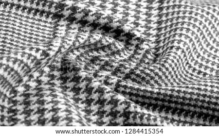 Background texture, pattern. The fabric is thick, warm with a checkered pattern, gray black. This is an unforgettable encounter with my fabric. The best design solutions are waiting for you. #1284415354