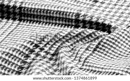 Background texture, pattern. The fabric is thick, warm with a checkered pattern, gray black. This is an unforgettable encounter with my fabric. The best design solutions are waiting for you. #1374861899