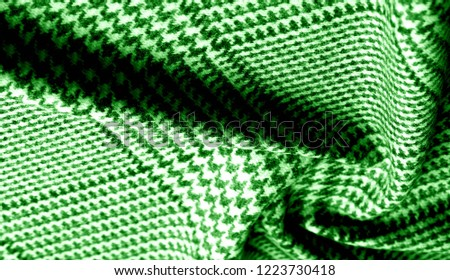 Background texture pattern. The fabric is thick, warm with a checkered pattern green This soft double damping with a light weight is ideal for design and more! Features yarn dyed checkered dark green #1223730418