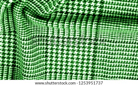 Background texture pattern. The fabric is thick, warm with a checkered pattern green This soft double damping with a light weight is ideal for design and more! Features yarn dyed checkered dark green #1253951737