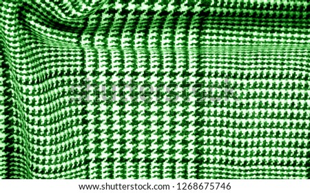 Background texture pattern. The fabric is thick, warm with a checkered pattern green This soft double damping with a light weight is ideal for design and more! Features yarn dyed checkered dark green #1268675746
