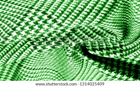 Background texture pattern. The fabric is thick, warm with a checkered pattern green This soft double damping with a light weight is ideal for design and more! Features yarn dyed checkered dark green #1314025409