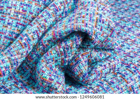 Background texture, pattern. Winter fabric, warm. big braided thread. Blue-red yellow threads. This photo will make your design the best. Wallpapers, pictures, posters. #1249606081