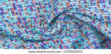 Background texture, pattern. Winter fabric, warm. big braided thread. Blue-red yellow threads. This photo will make your design the best. Wallpapers, pictures, posters. #1430820692
